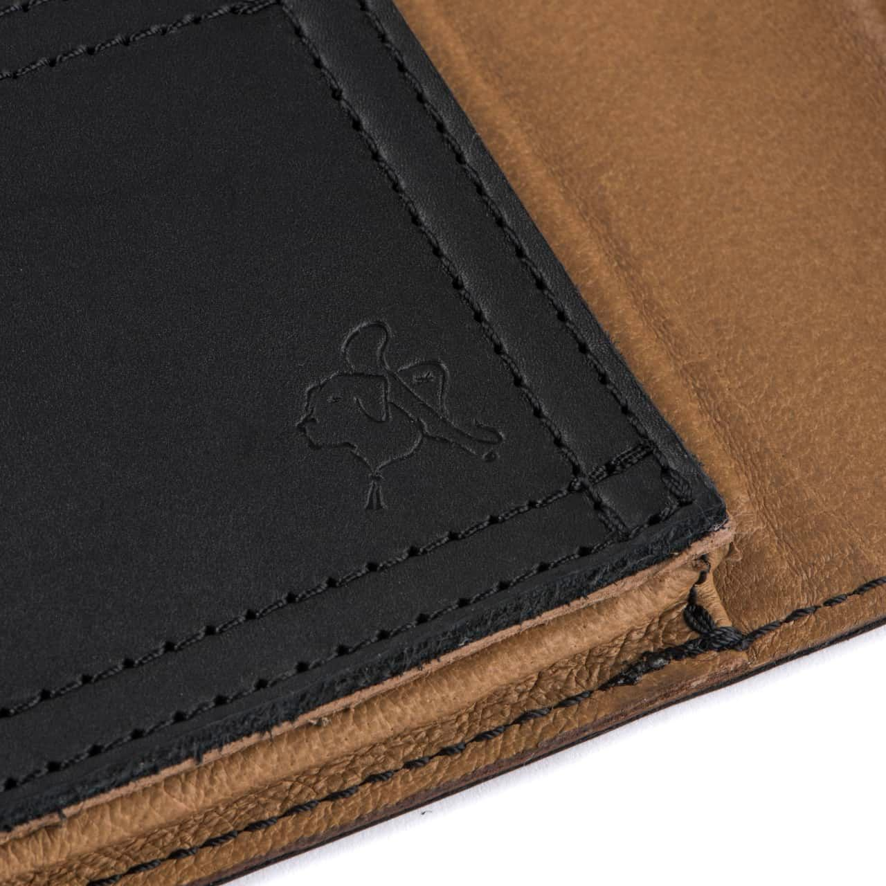 Leather Tablet Notepad Holder Zoomed in on Blue the Dog Stamp in the Color Black