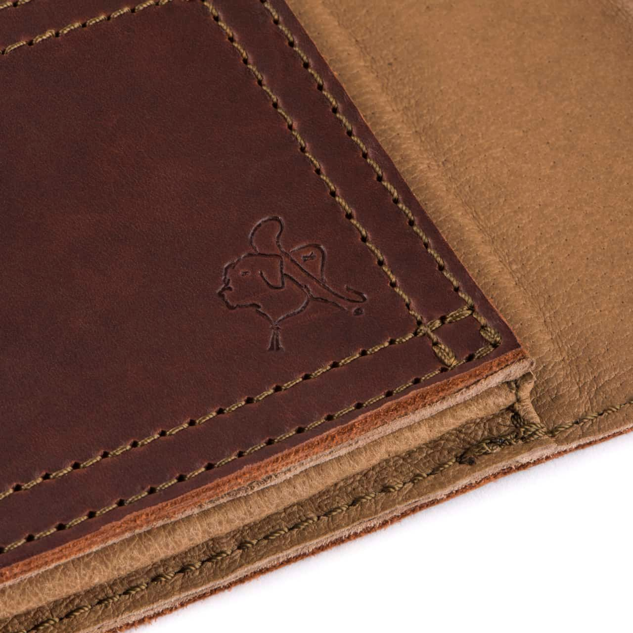 Leather Tablet Notepad Holder Zoomed in on Blue the Dog Stamp in the Color Chestnut