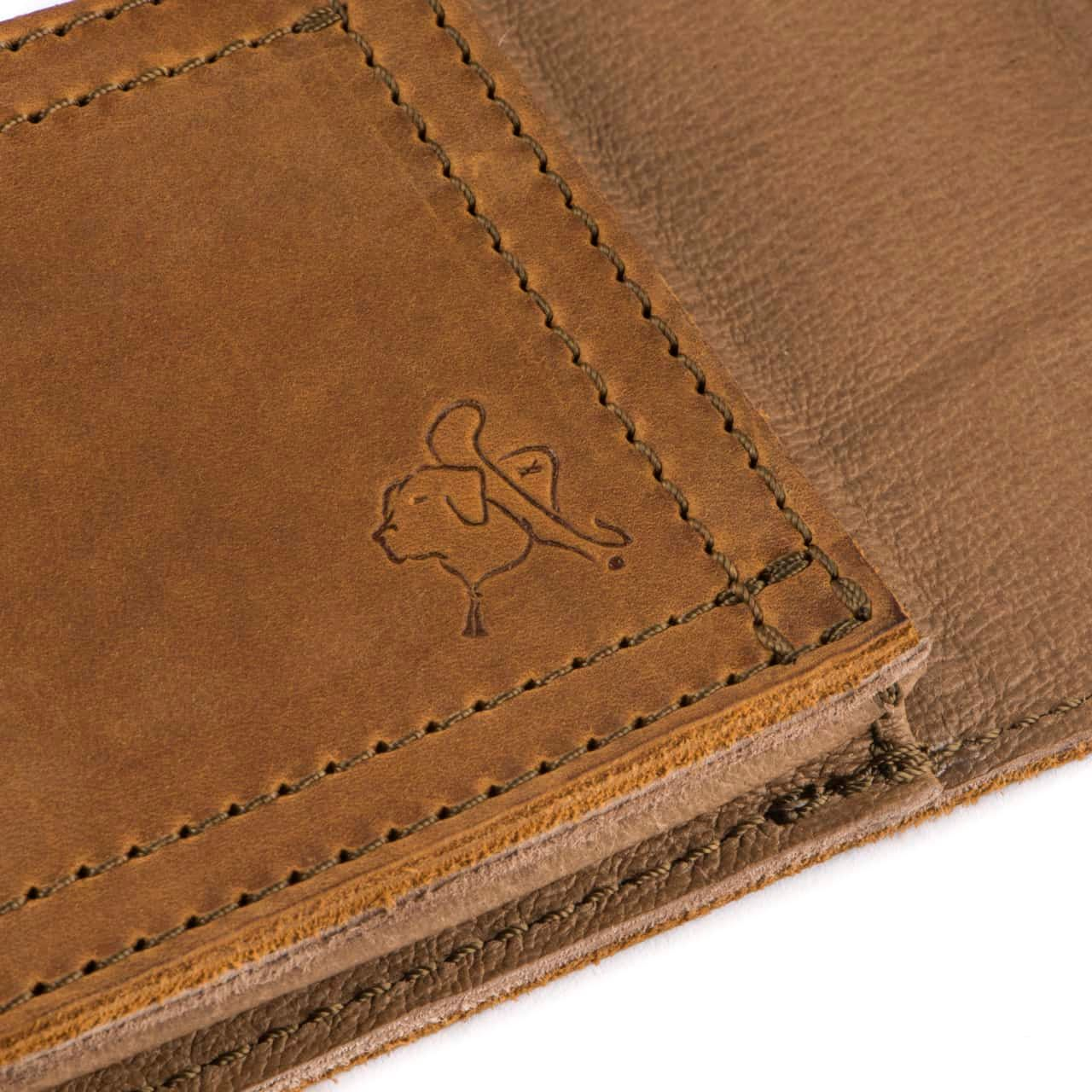 Leather Tablet Note Holder Zoomed in on Blue the Dog Embossment in the Color Tobacco