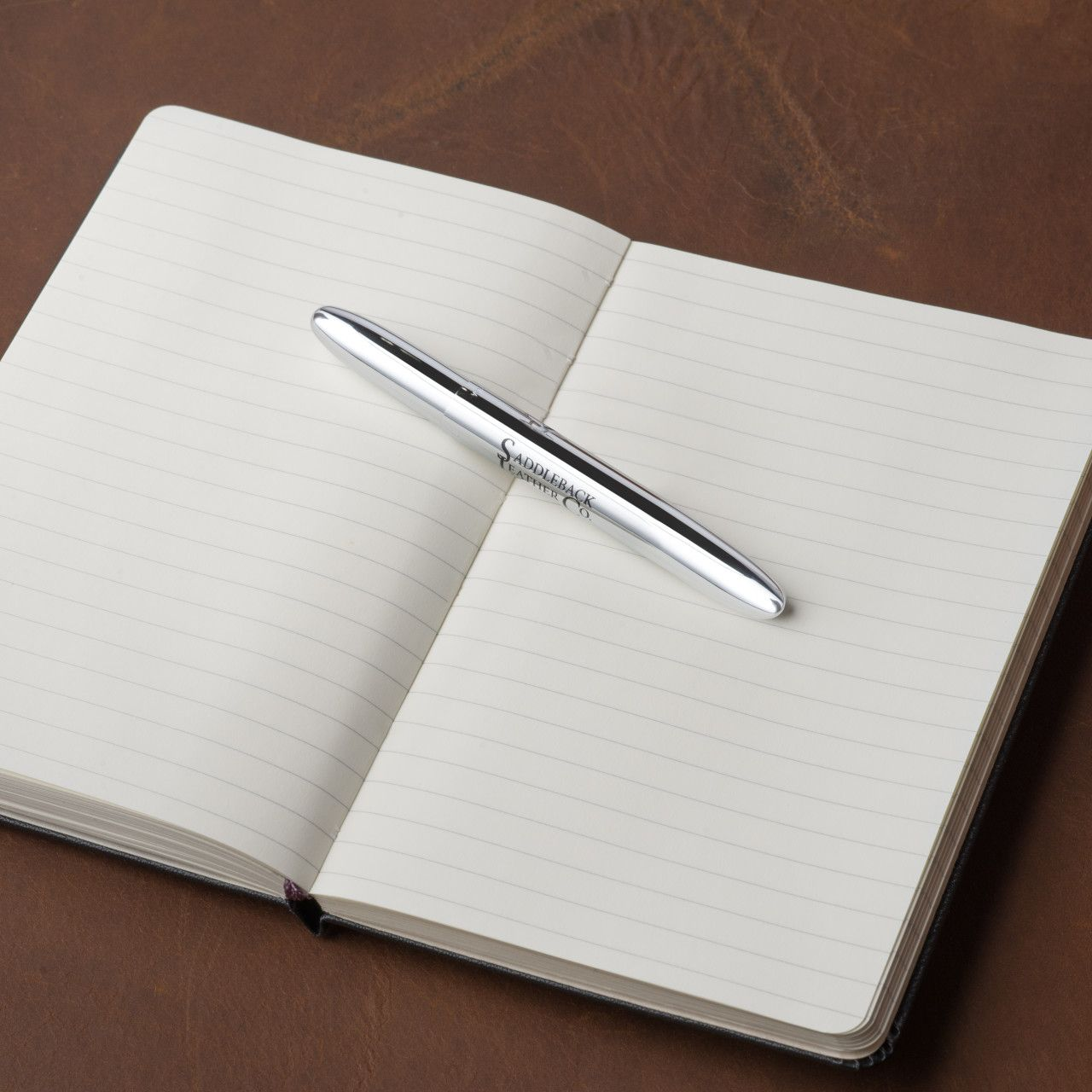 Notepad along with space pen medium in chrome leather