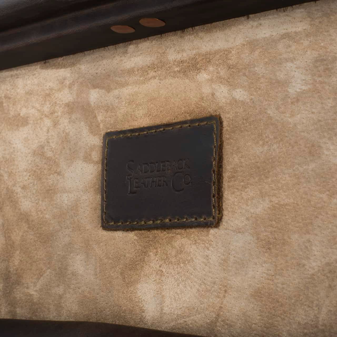 Leather Trunk in color Dark Coffee Brown Zoomed in onthe Saddleback Brand on the Interior of the Lid