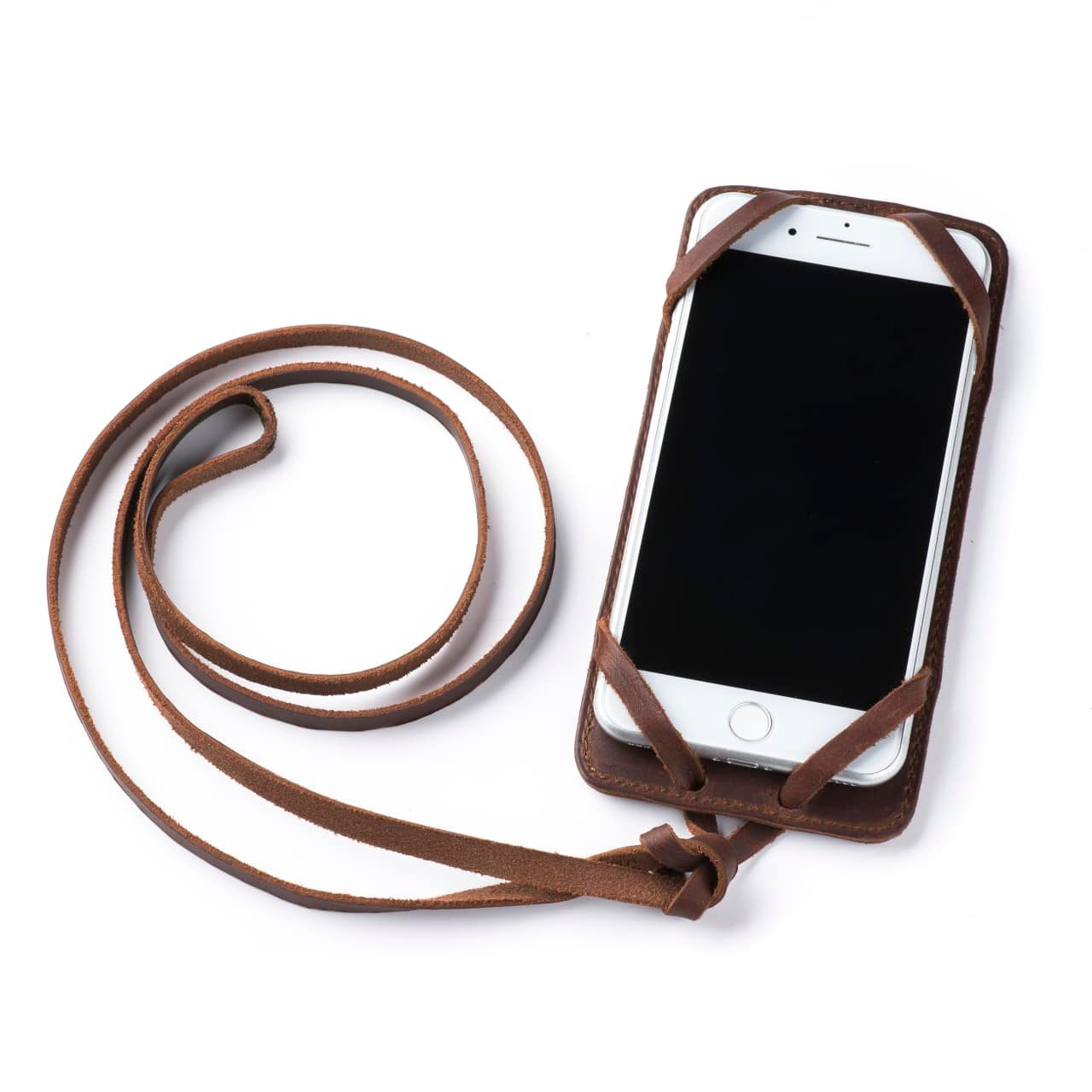 Leather iPhone 8+ Case in Color Chestnut with the Lanyard attached front angle with phone in the case