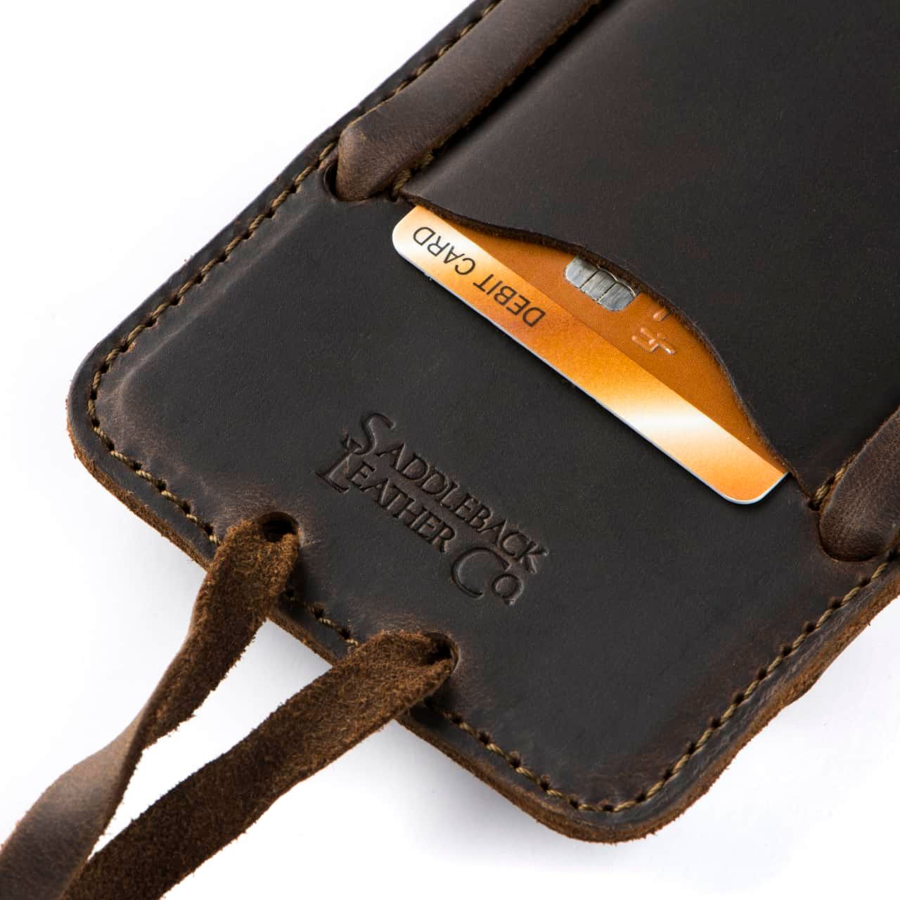 Leather iPhone 8+ Case in Color Dark Coffee Brown Zoomed in on the Saddleback Logo and Card Slot with a Card