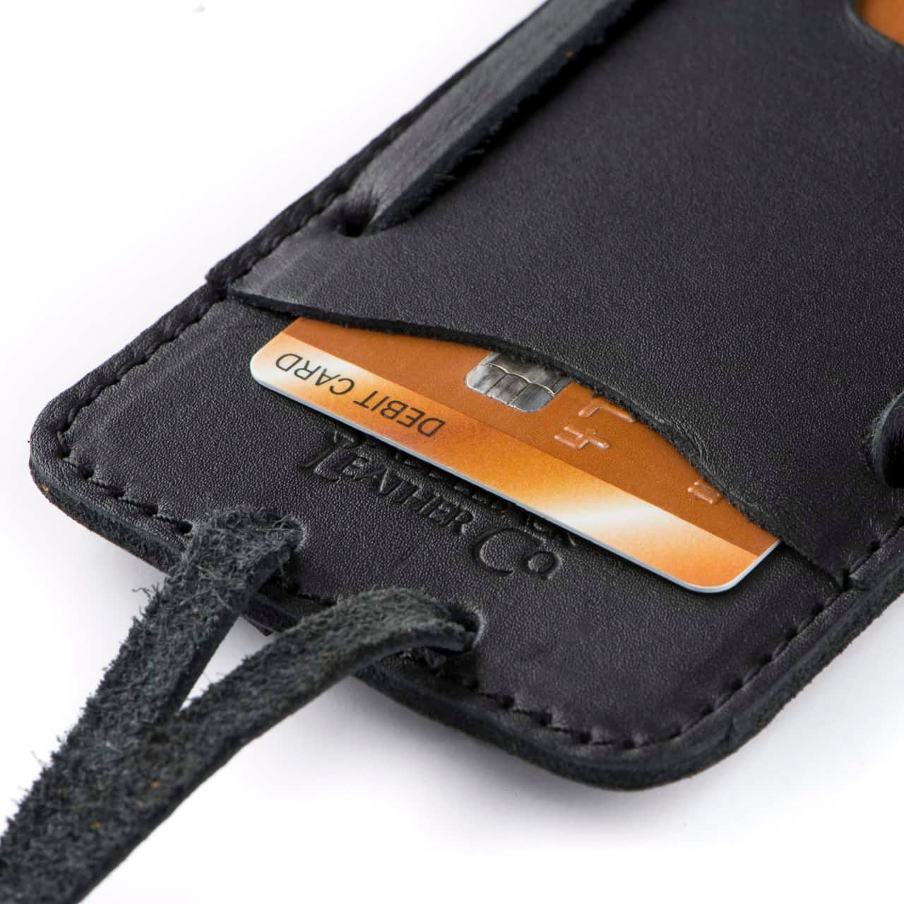 Leather iPhone 8 Case in Color Black Zoomed in on the Saddleback Logo and Card Slot with a Card