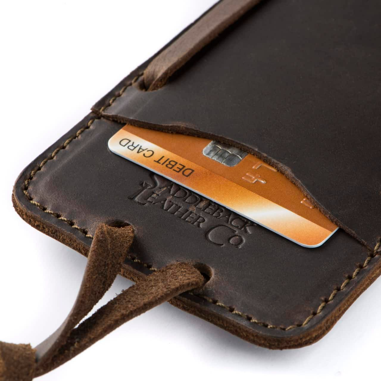 Leather iPhone 8 Case in Color Dark Coffee Brown Zoomed in on the Saddleback Logo and Card Slot with a Card