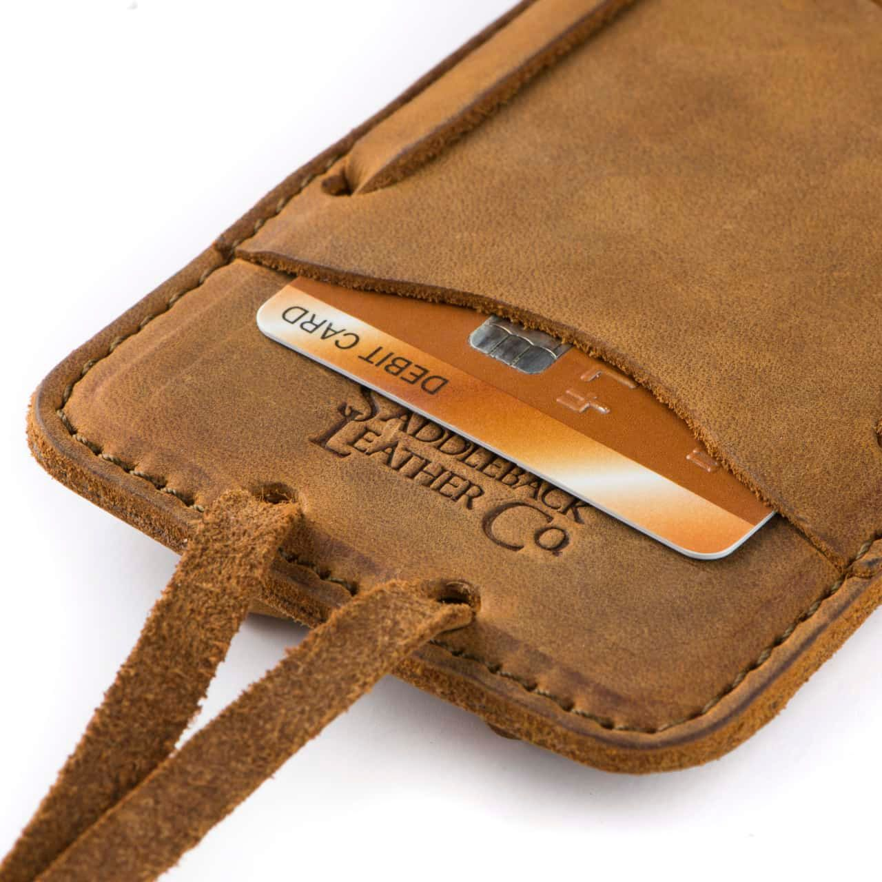 Leather iPhone 8 Case in Color Tobacco Zoomed in on the Saddleback Logo and Card Slot with a Card