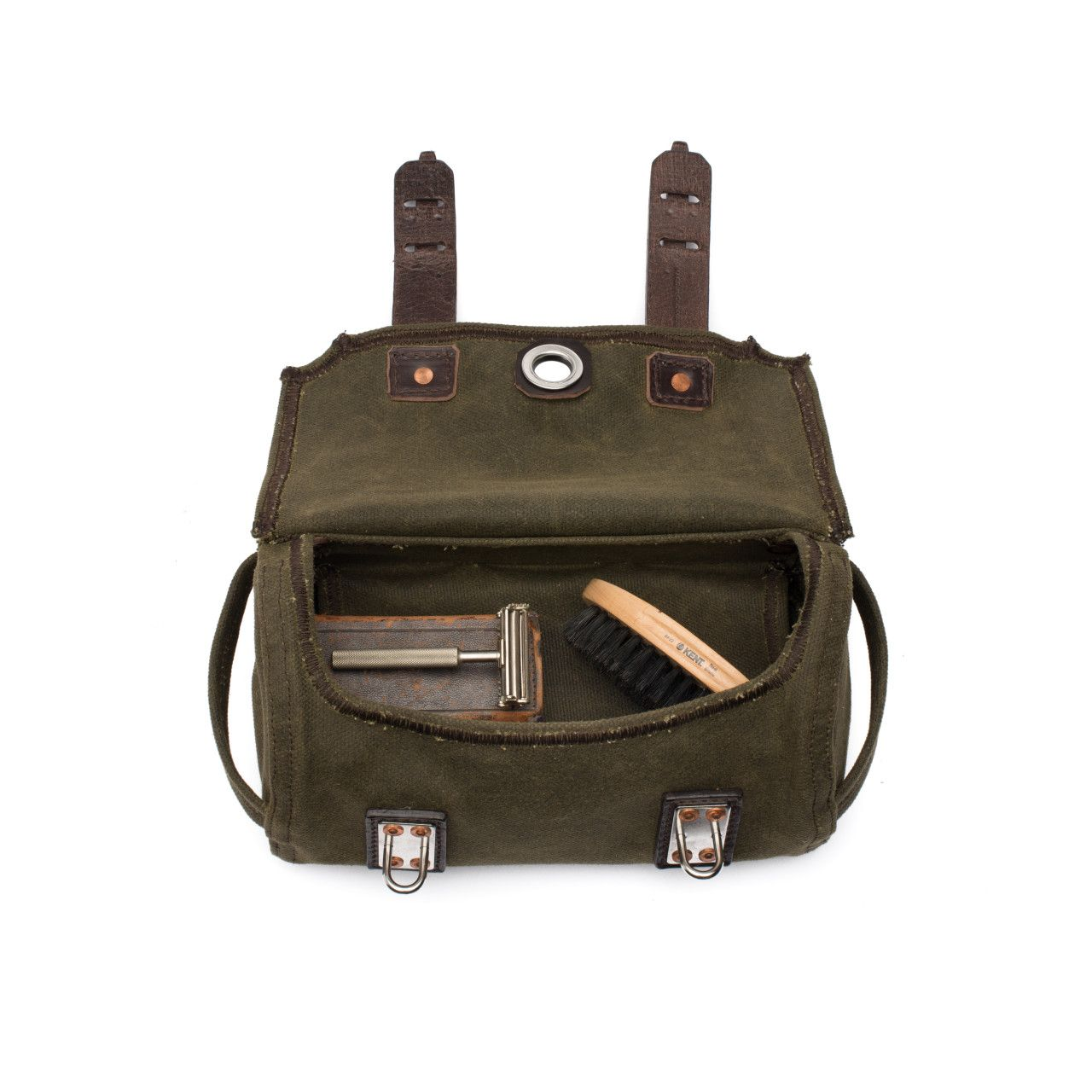 canvas dopp kit medium in moss green canvas with a brush and razor in the interior