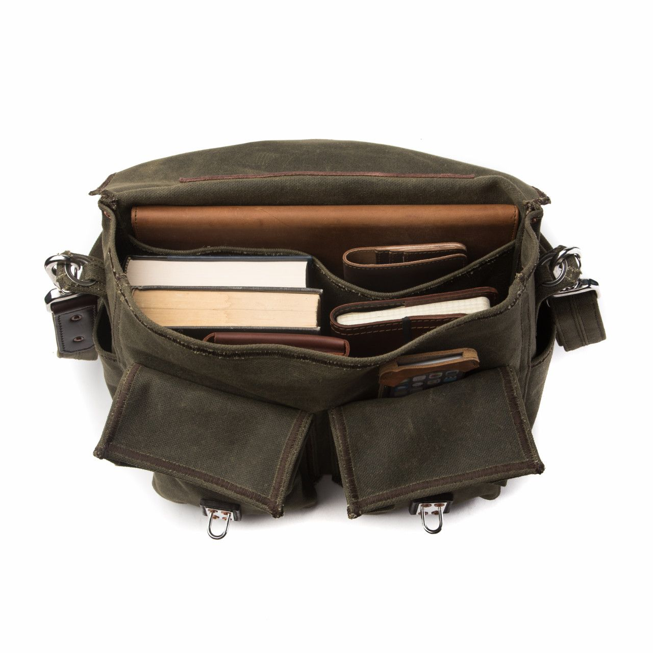 front pocket canvas gear bag medium in moss green canvas with books, wallet and notebook in the interior
