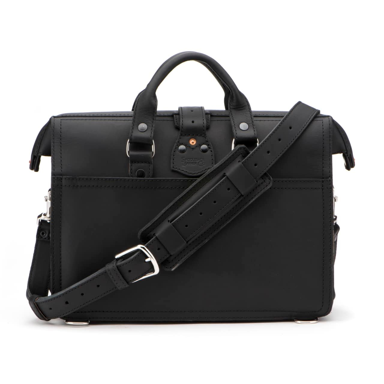 Leather Flight Bag in color Black shown from the back with the Shoulder Strap