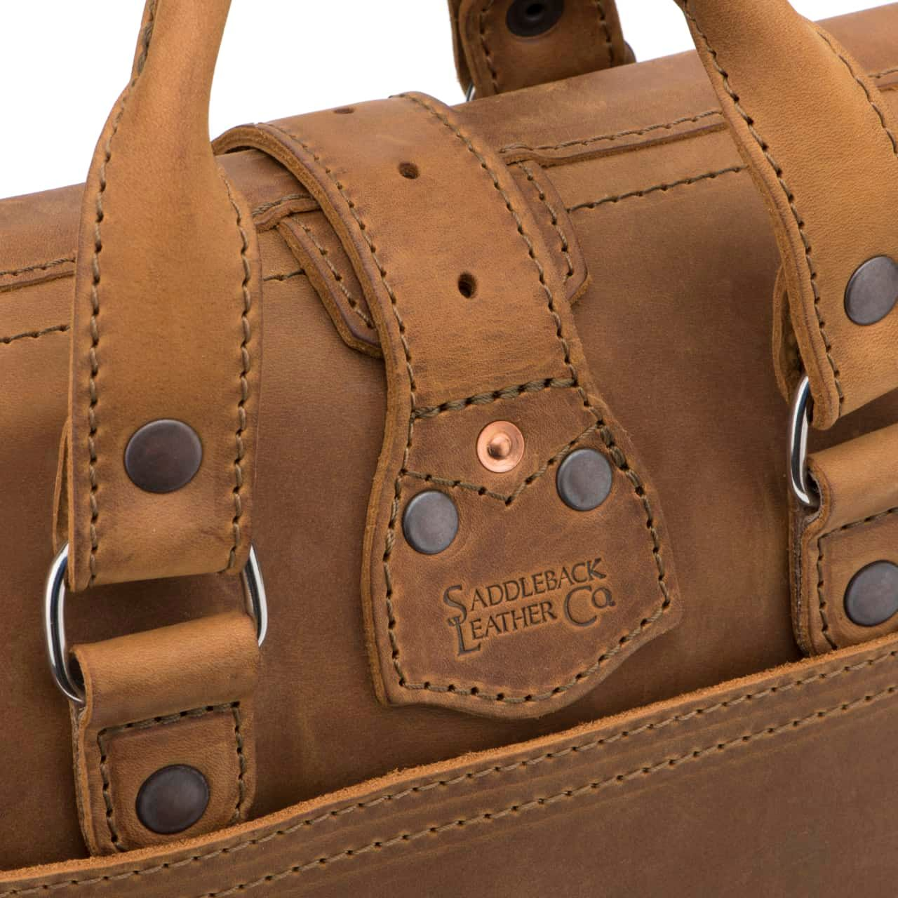 Leather Flight Bag in color Tobacco zoomed in on the Saddleback Brand on the Back