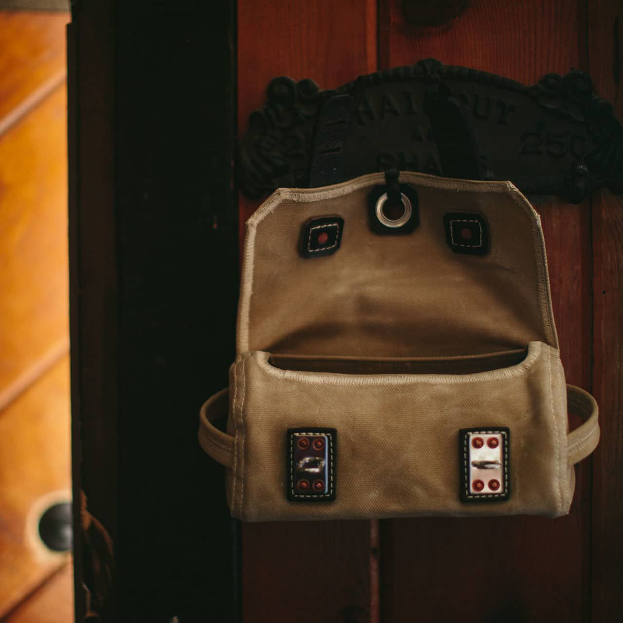 Dopp Kit in Color Sand Hanging on a Hook