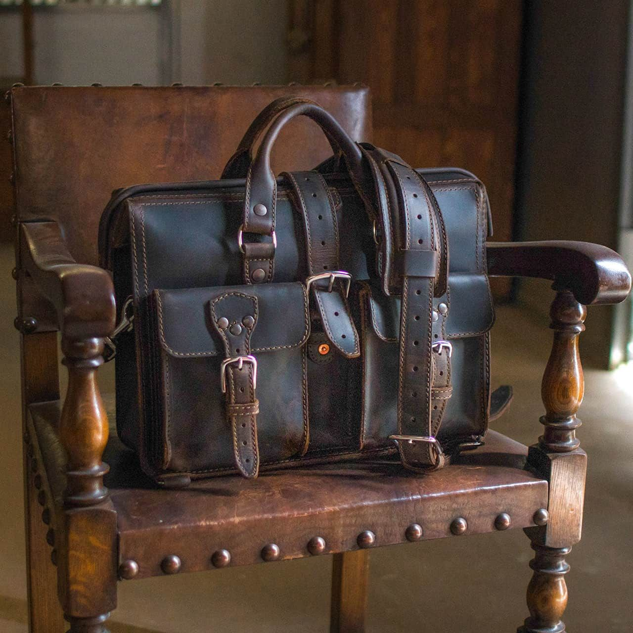 Leather Flight Bag sitting Grandly in a Chair