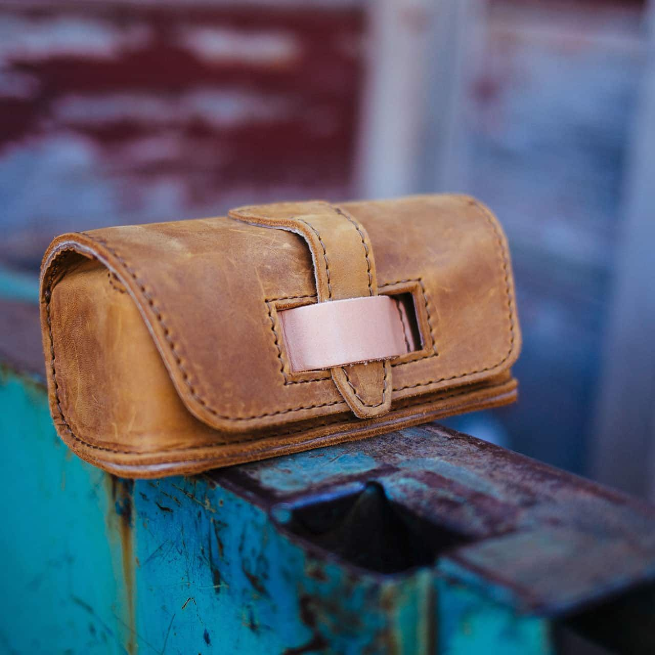 Hard Sunglass Case - Tobacco - Closed Against a Colorful Backdrop