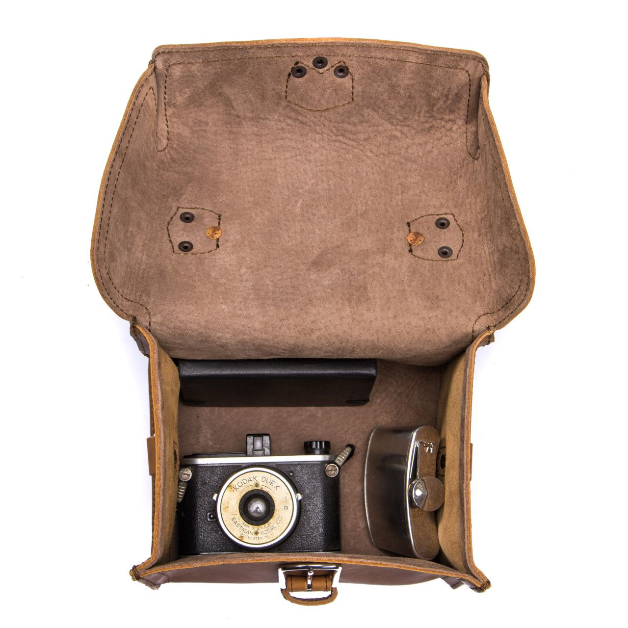 For your most valuable souvenirs suitcase will be leather gadget bag medium in tobacco leather