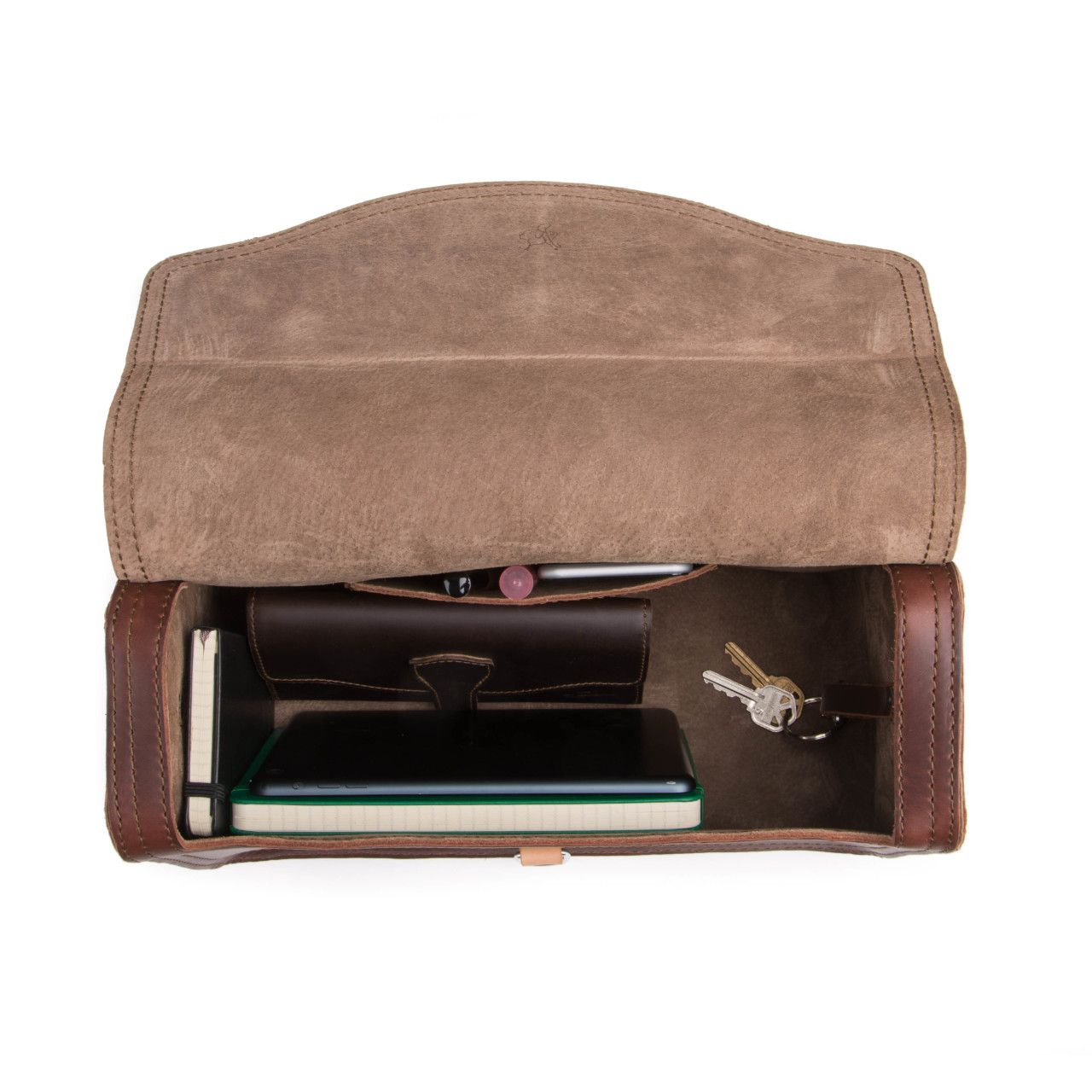 leather satchel purse in chestnut leather with keys and wallet inside