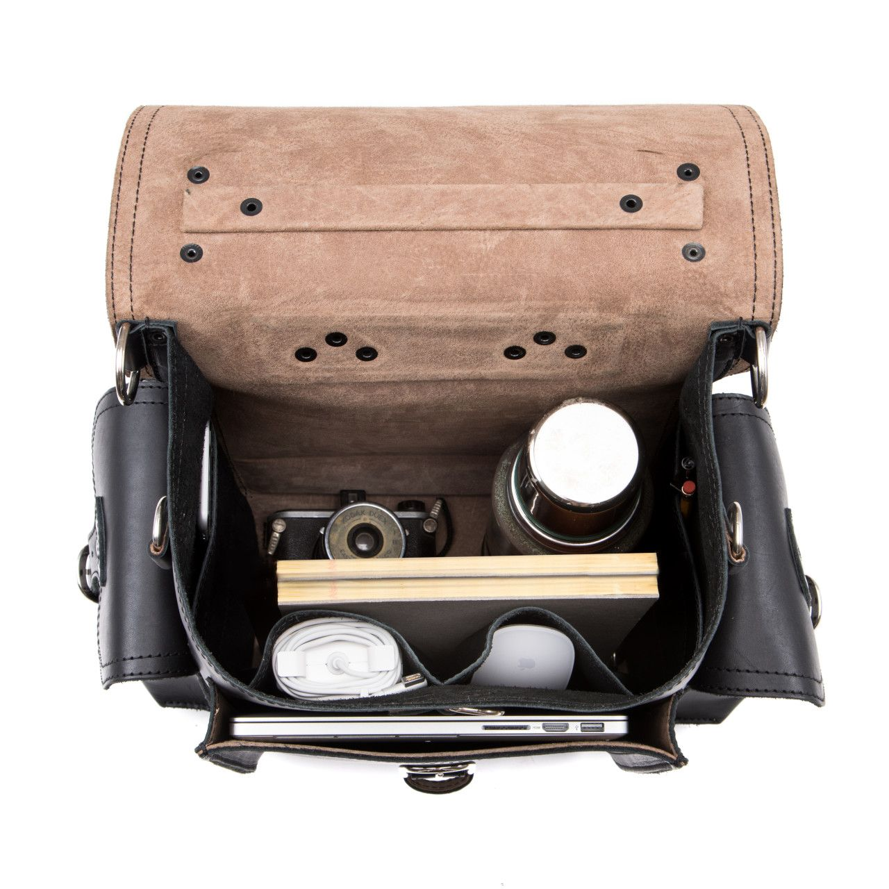 An old camera and a macbook with a set to handle the inside of the squared leather backpack in black leather