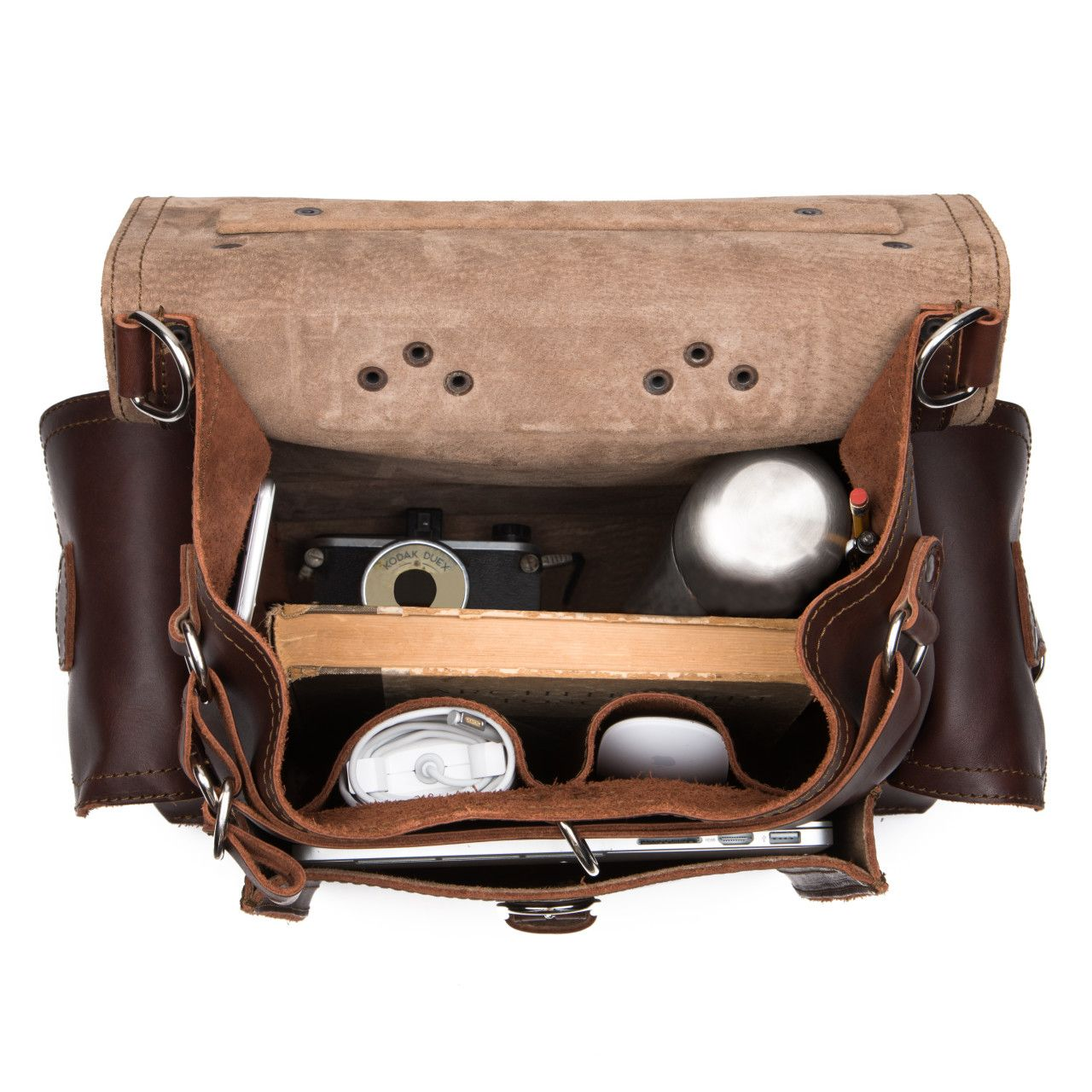 An old camera and a macbook with a set to handle the inside of the squared leather backpack in chestnut leather