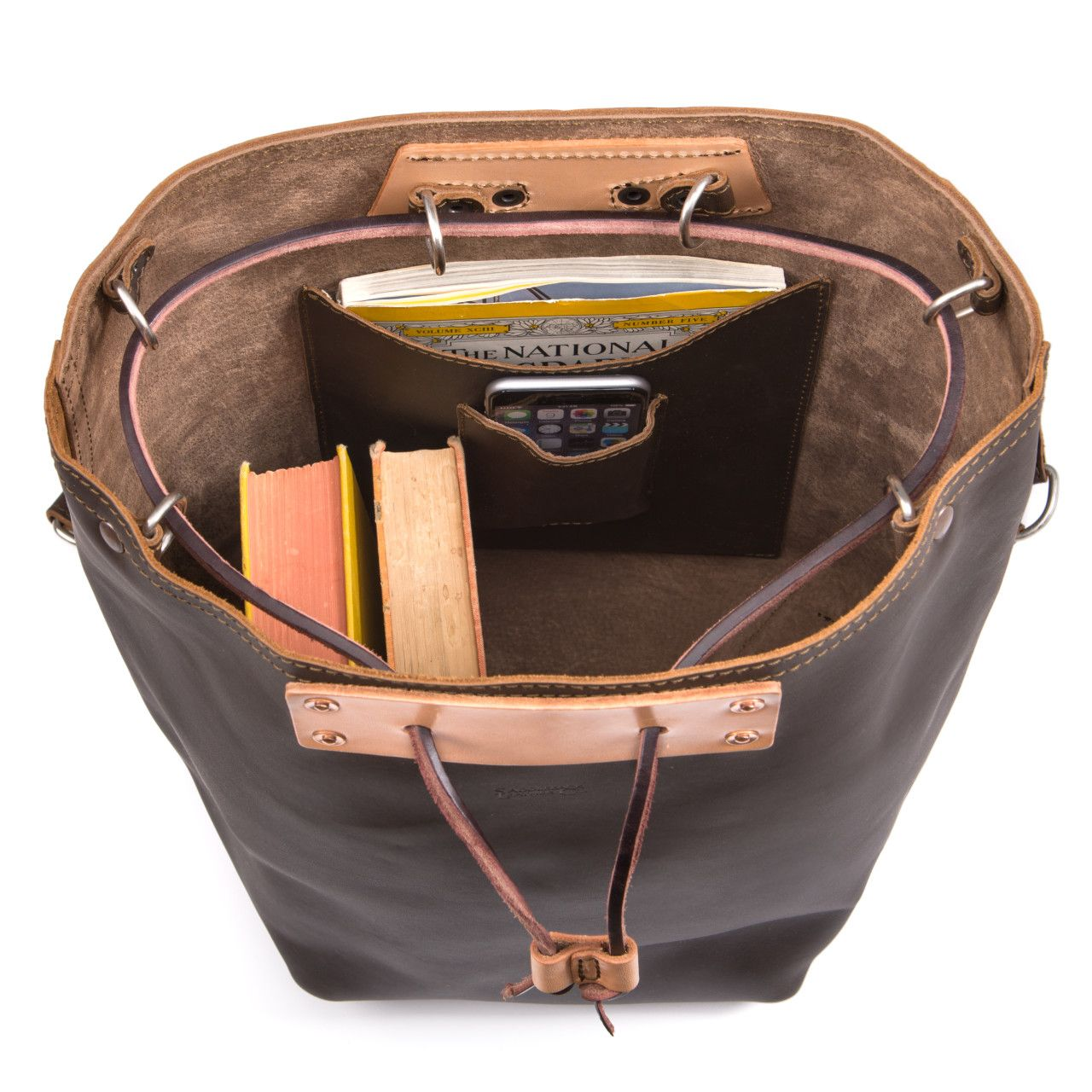 Two books, iphone, map in the inside of the bucket drawstring leather backpack in dark coffee brown leather