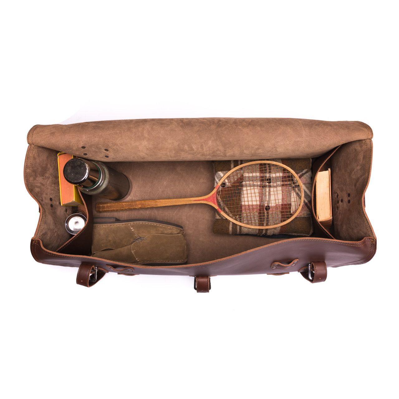 large leather duffel bag in chestnut leather with shoes, books, badminton racket, thermos in the interior