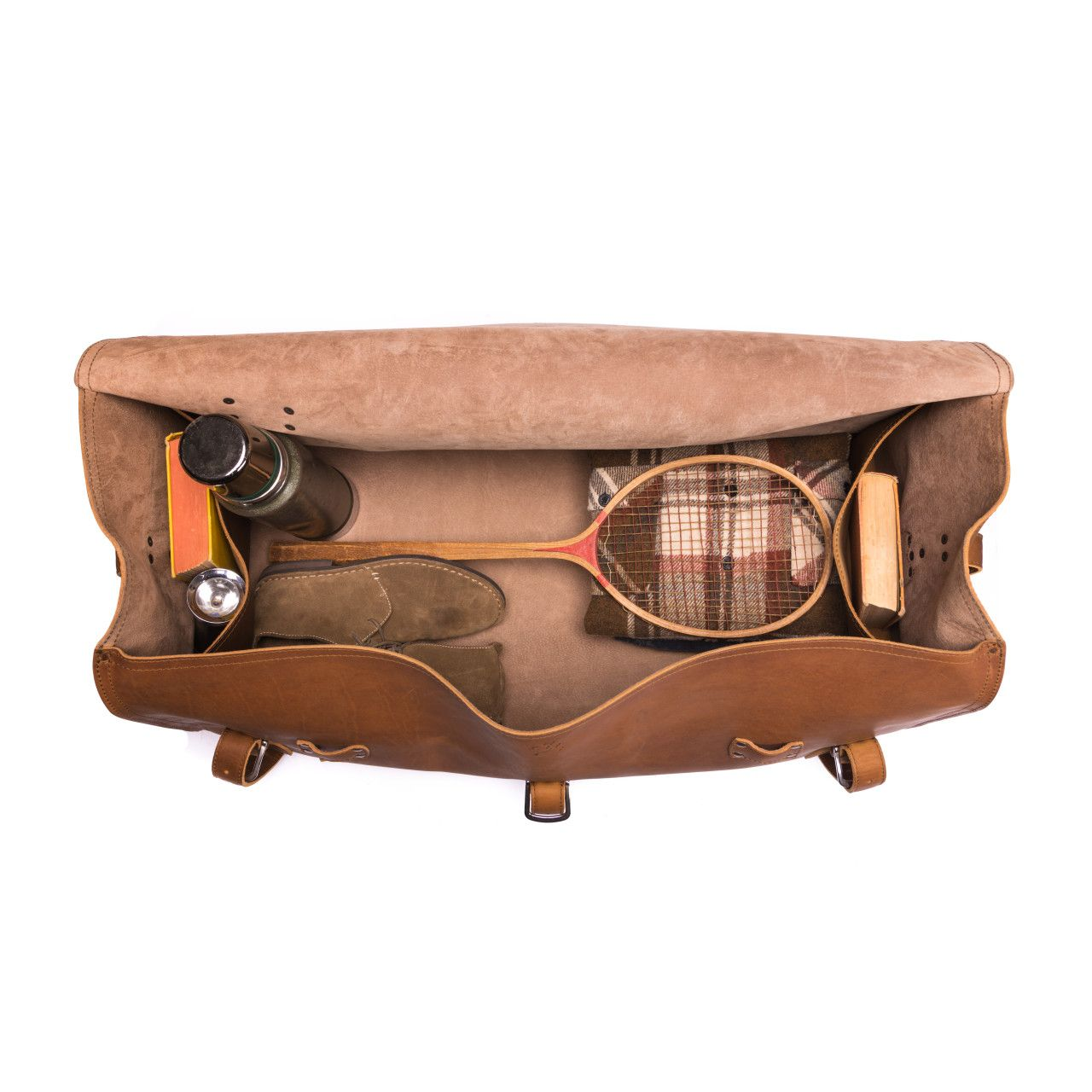 large leather duffel bag in tobacco leather with shoes, books, badminton racket, thermos in the interior