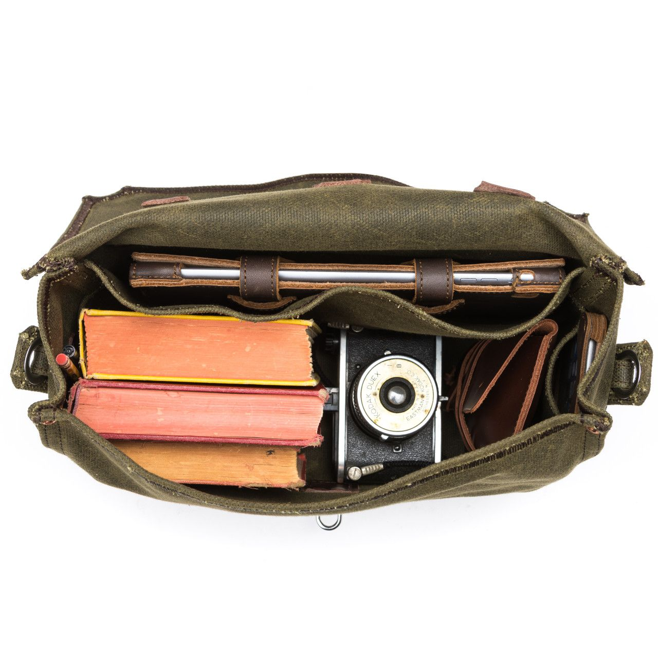 medium waxed canvas gear bag in moss green canvas with books, camera and tablet inside