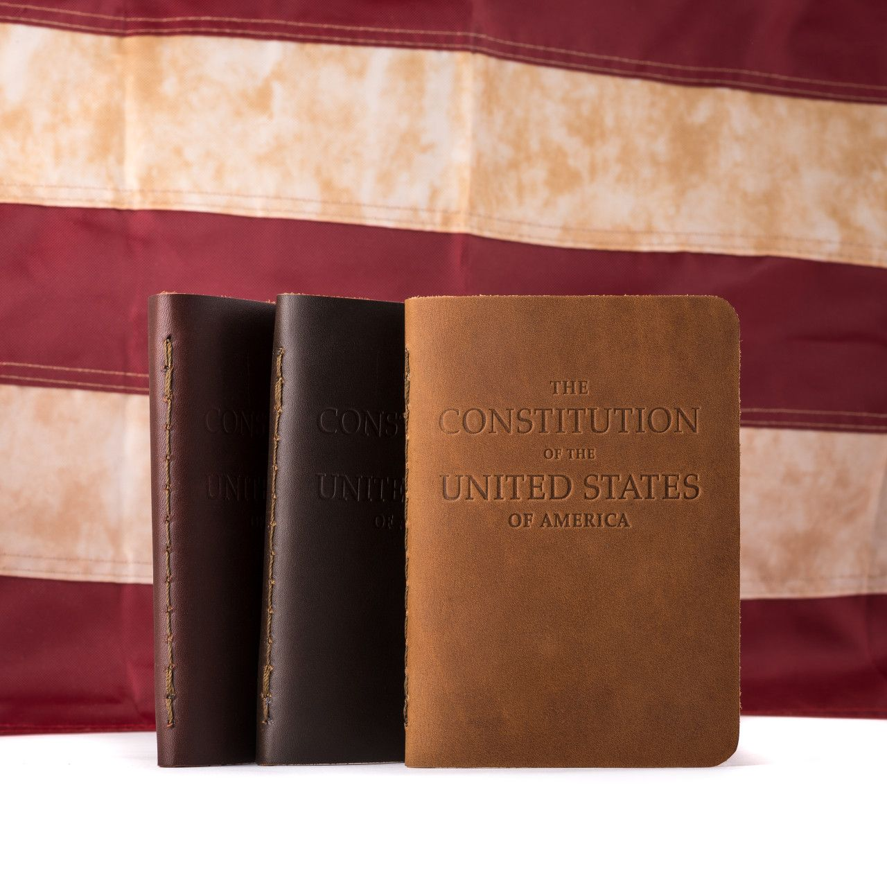 Set of the leather bound constitution in leather on the flag background