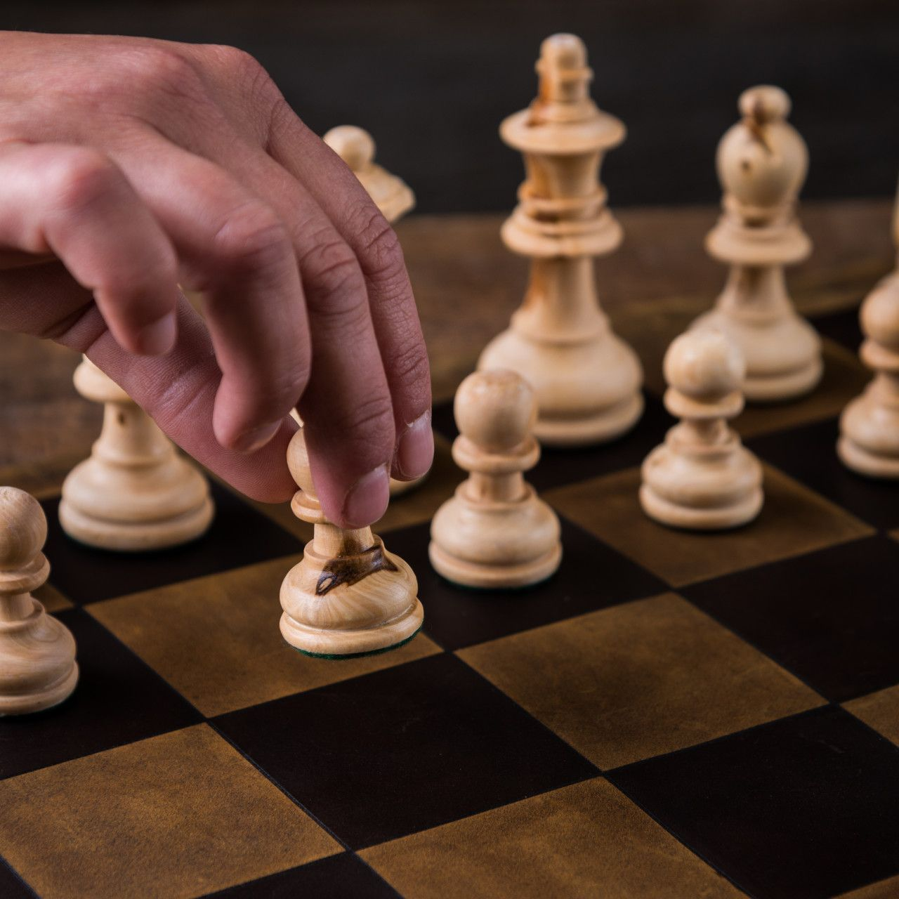 A leather chess and checkers set large in tobacco leather chess seen during the game
