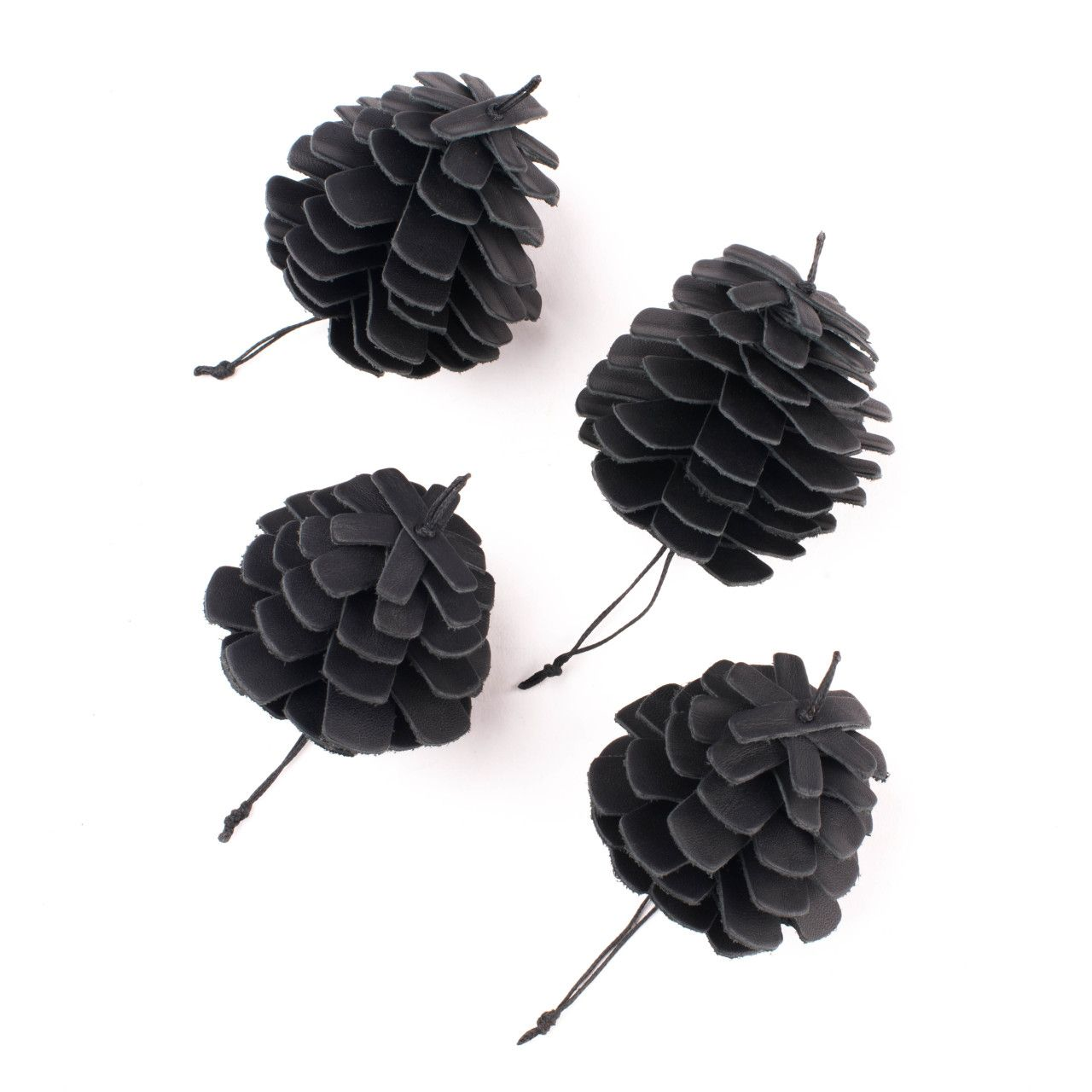 leather pine cone ornament set in black leather