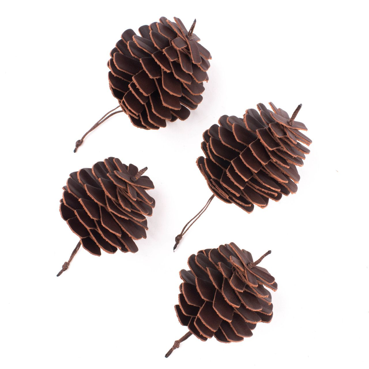 leather pine cone ornament set in chestnut leather