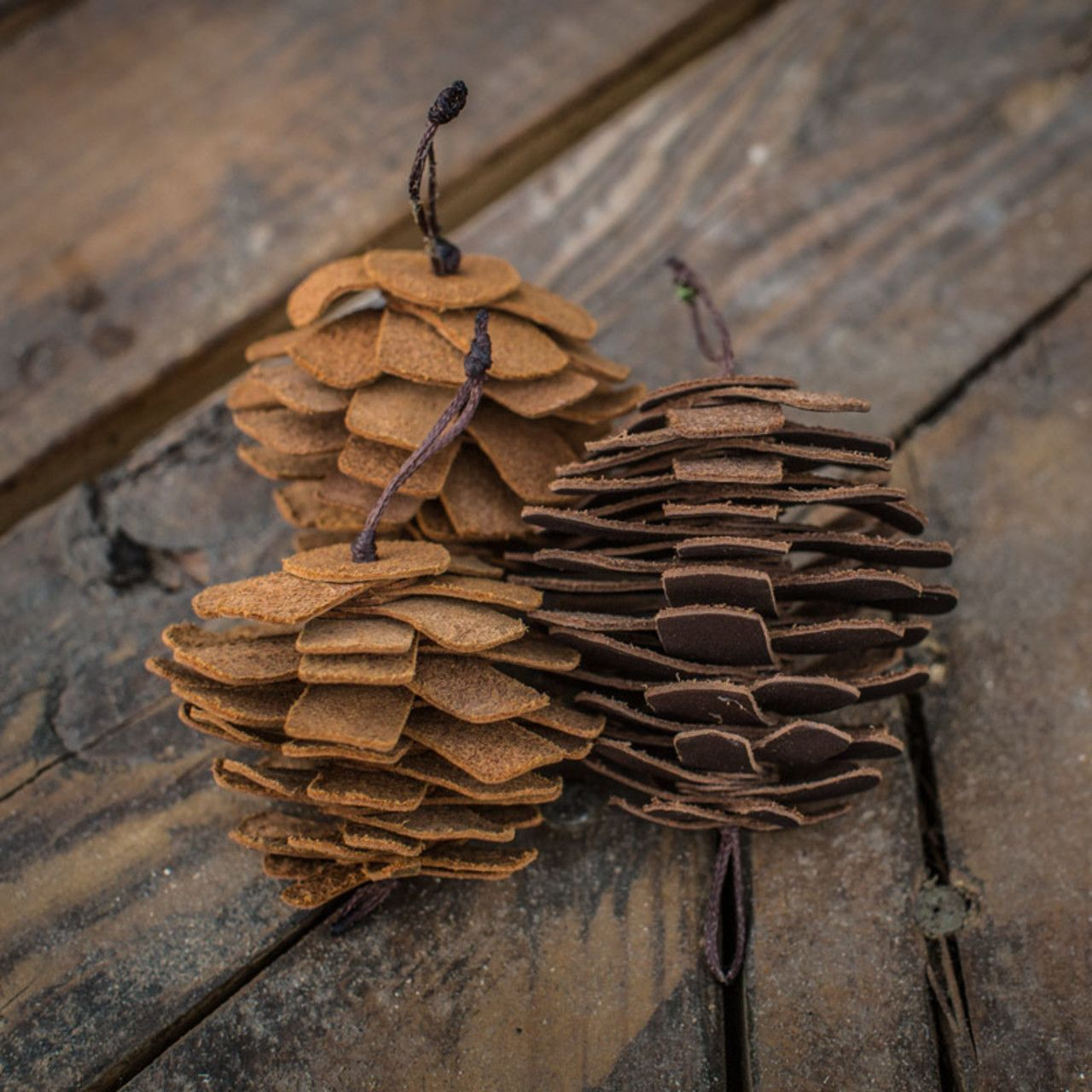 Set of 3 leather pine cone ornament set in tobacco leather