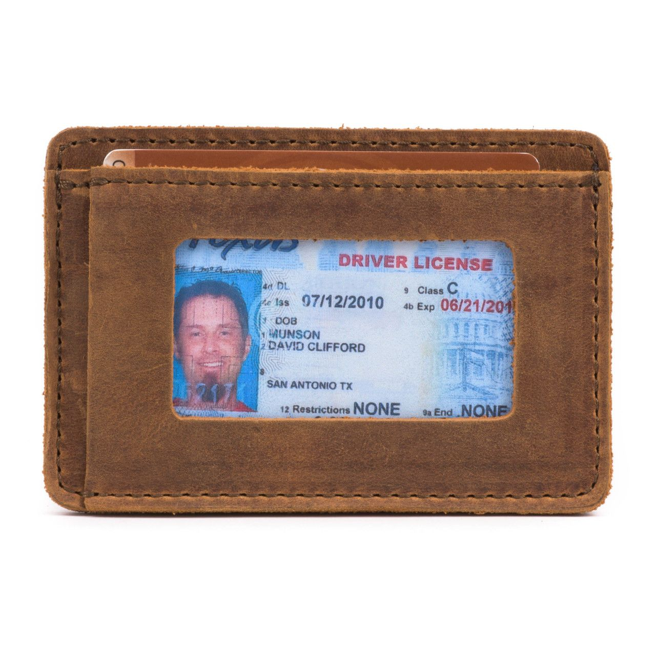 leather front pocket wallet in tobacco leather with a visible driving license