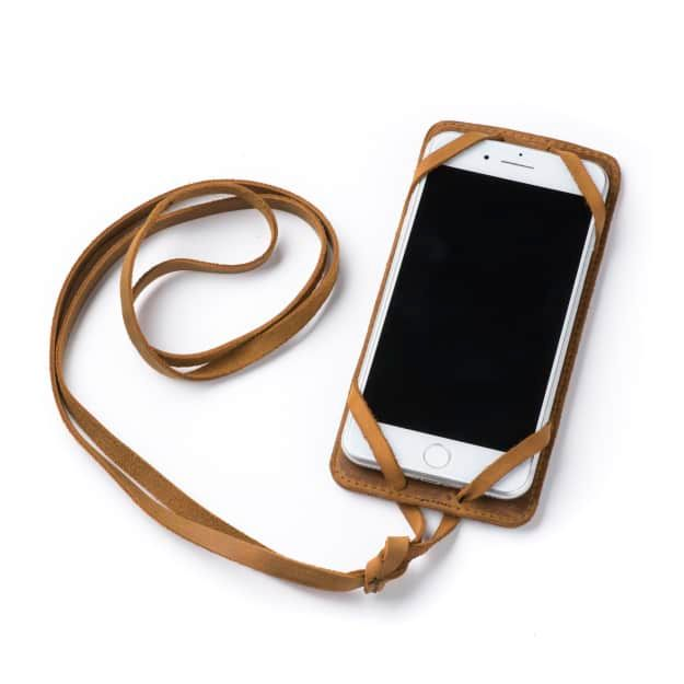 Leather iPhone 8+ Case in Color Tobacco with the Lanyard attached front angle with phone in the case