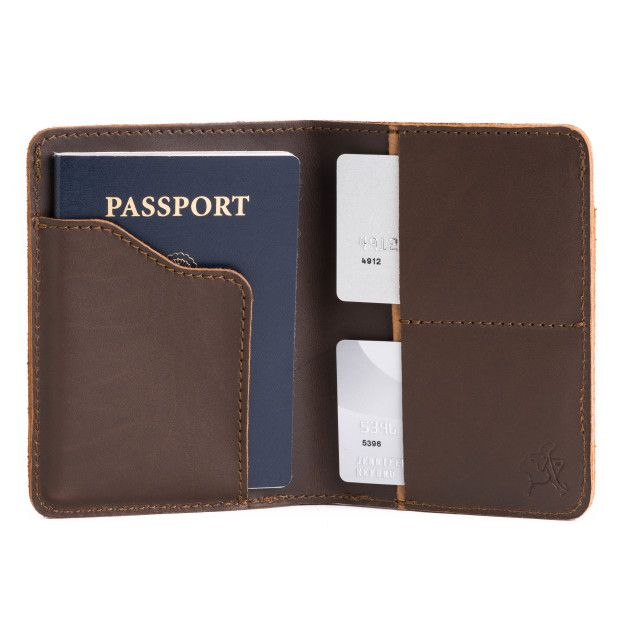 leather passport wallet in dark coffee brown leather with a passport and payment cards