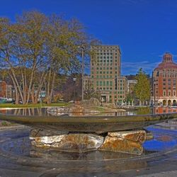 photo of fountain in Pack Square Park, Asheville NC overlooking iconic city and county buildings