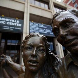 photo of dancers sculpture in front of the US Cellular Center along the Asheville Urban Trail