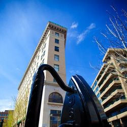photo of large iron sculpture in front of Flat Iron building in downtown Asheville NC