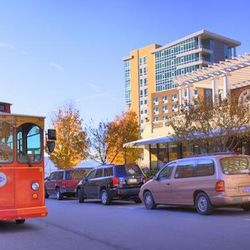 photo of Asheville's Historic Trolley driving through downtown