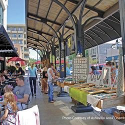 Photo of shoppers and diners outside Grove Arcade in Asheville NC