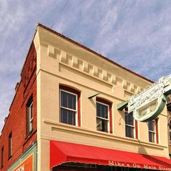 Photo of Painted brick building with red awning in Hendersonville