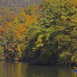 Person kayaking down Lake Lure