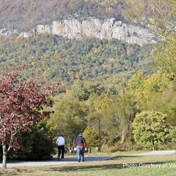 People enjoy a nice outing while walking around Lake Lure