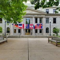 Photo of Haywood County Courthouse Decorated with a Banner of Flags