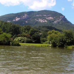 Photo of Lake Lure with a grassy Patch