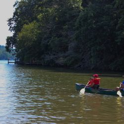 Photo of 2 People canoeing down the river