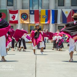 Photo of Dancers Dressed in Purple Robes Outside