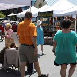 People Enjoying a Day and Looking at the Arts and Crafts at the Market
