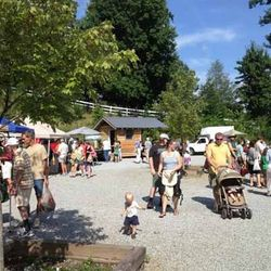 Photo of People Enjoying the Day at the Market in Saluda