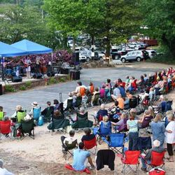 Photo of People Gathering to Hear Music at a Local Saluda Outdoor Event