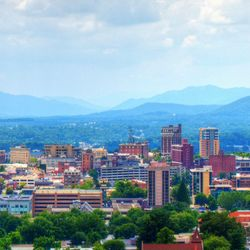 photo of Asheville city skyline with Blue Ridge Mountains in background
