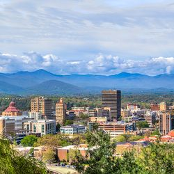 photo of Asheville City Skyline with Blue Ridge Mountains in the background